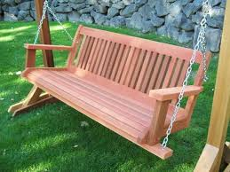 A Beautiful Wood Swing Stand on Green Grass
